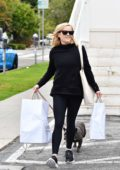 Reese Witherspoon steps out in all black as she goes shopping with her dog in Brentwood, California