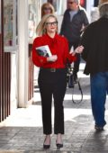 Reese Witherspoon wears a cute red top and black trousers as she stops by a local bookstore in Brentwood, Los Angeles