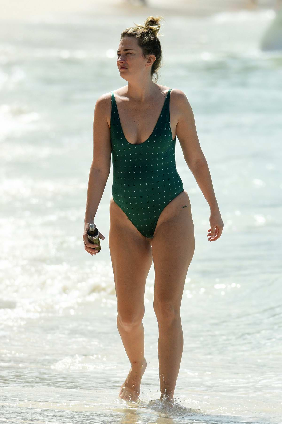 Rhea Durham seen wearing a green swimsuit as she enjoys a beach day in Barbados