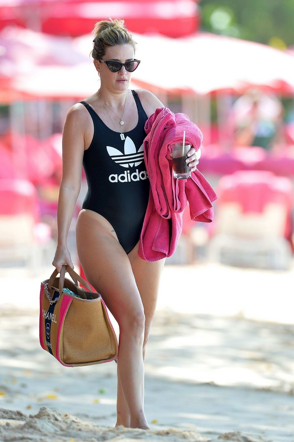Rhea Durham seen wearing black Adidas swimsuit while enjoying her winter holidays at the beach in Barbados