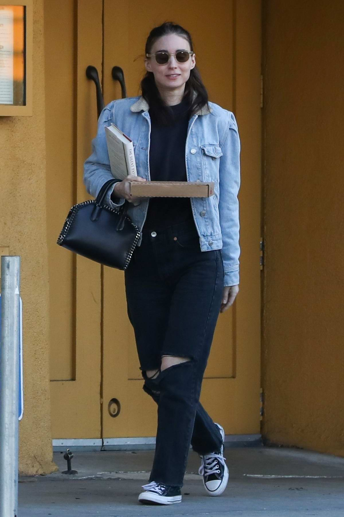 Rooney Mara leaves a famous pizza spot in Hollywood, California