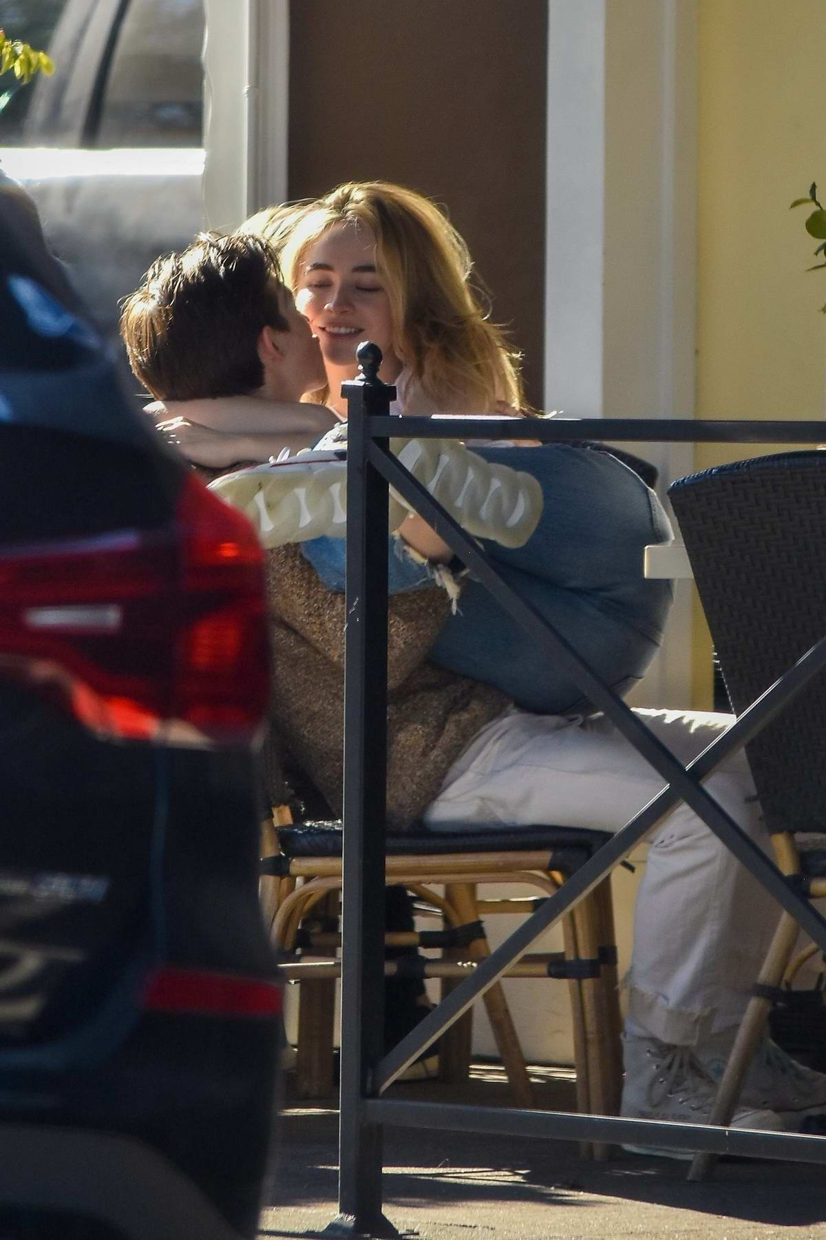 Sabrina Carpenter and Griffin Gluck pack on some PDA during their lunch date at Sweet Butter in Studio City, California