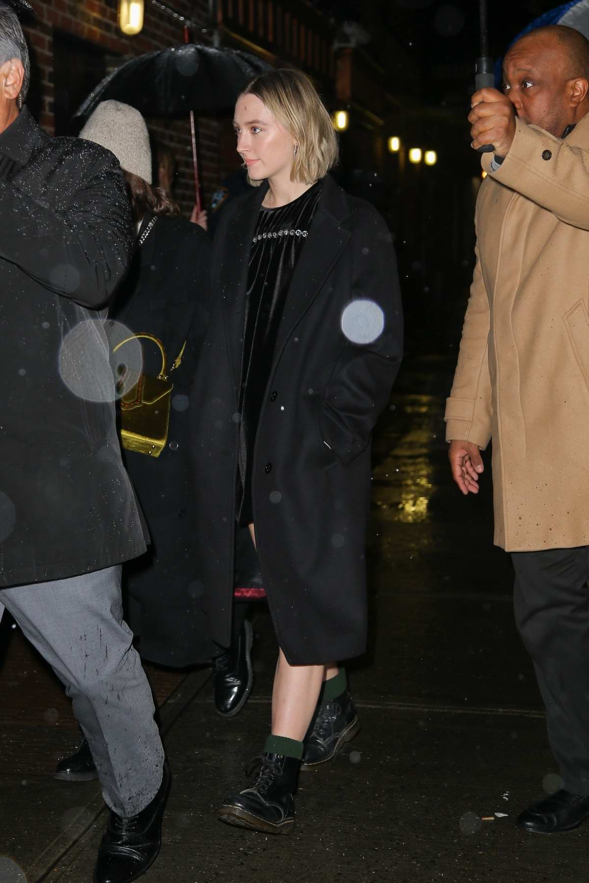 Saoirse Ronan spotted in a black mini dress and black long coat as she steps out in New York City