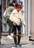 Sarah Hyland wears a fuzzy sweater with black leggings and rain boots as she steps out in Los Angeles
