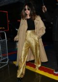 Selena Gomez dazzles in gold pants while out in London, UK
