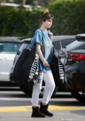 Selena Gomez dons an oversized vintage t-shirt with Malibu sweatpants during a shopping trip to Urban Outfitters in Los Angeles