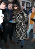 Selena Gomez rocks double denim with an animal print coat as she steps out in London, UK