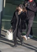 Selena Gomez spotted in a fur jacket as she touches down at Heathrow Airport in London, UK