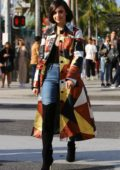 Sofia Carson looks stylish in a multi-colored long coat during a sidewalk interview on Rodeo Drive in Beverly Hills, California