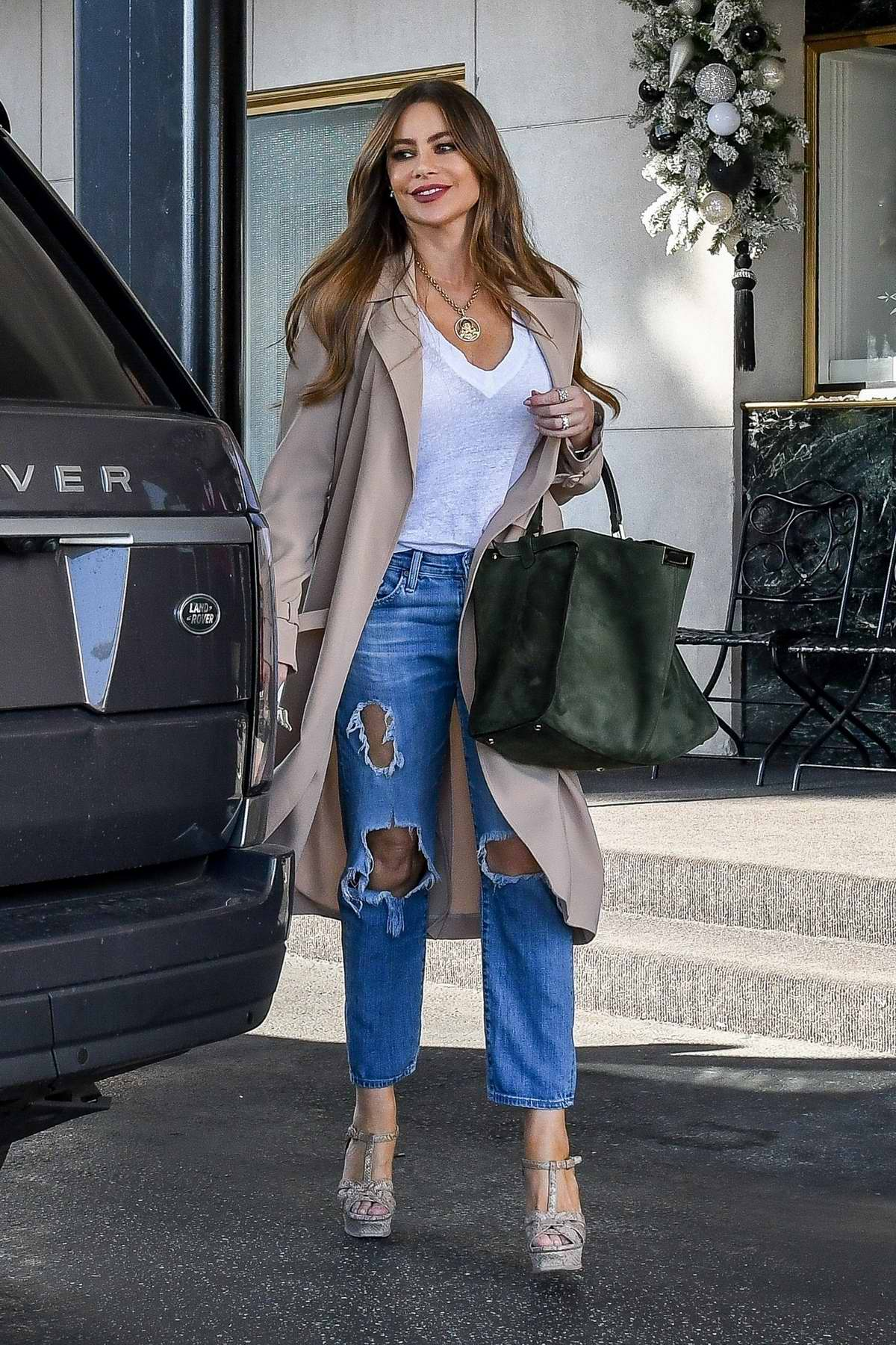 Sofia Vergara is all smiles as she ends a shopping trip at Saks Fifth Avenue in Beverly Hills, California