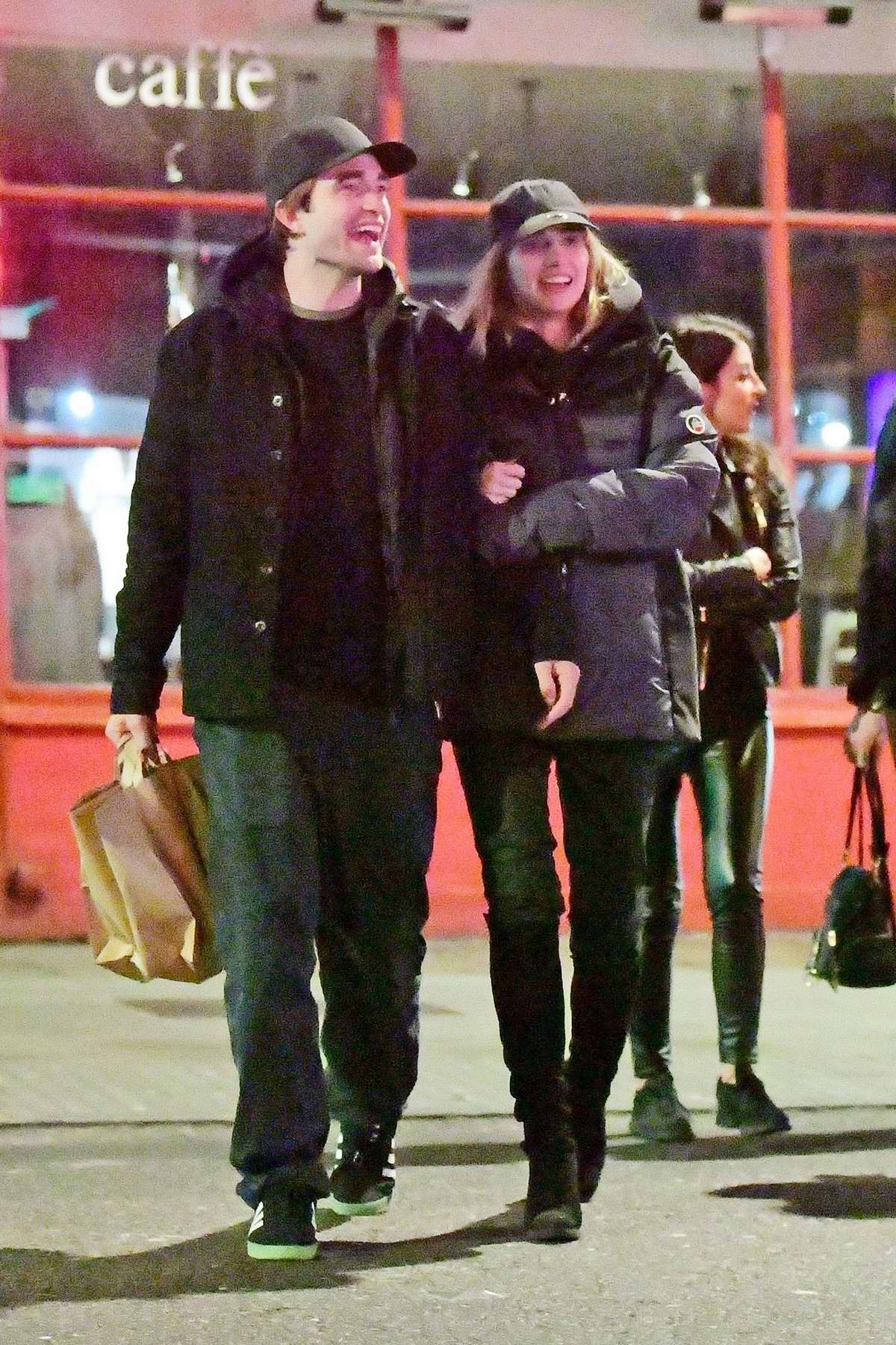 Suki Waterhouse and Robert Pattinson are all smiles as they step out for some shopping in London, UK