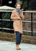 Suki Waterhouse keeps it comfy casual as she steps out while chatting on her phone in London, UK