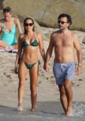 Sylvie Meis dons a green bikini while enjoying a day on the beach with fiance Niclas Castello in St Barts, France