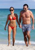 Sylvie Meis rocks a red bikini as she enjoys another relaxing day with Niclas Castello at the beach in Miami, Florida