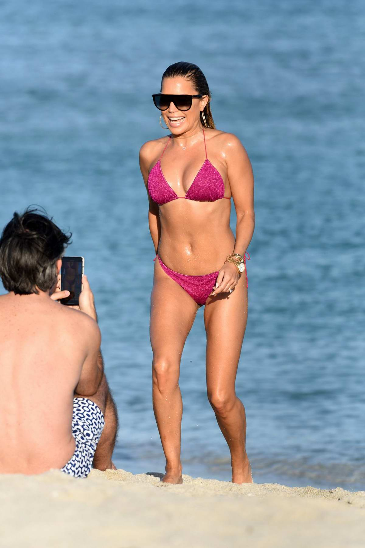 Sylvie Meis slips into a pink bikini as she hits the beach with Niclas Castello in Miami, Florida
