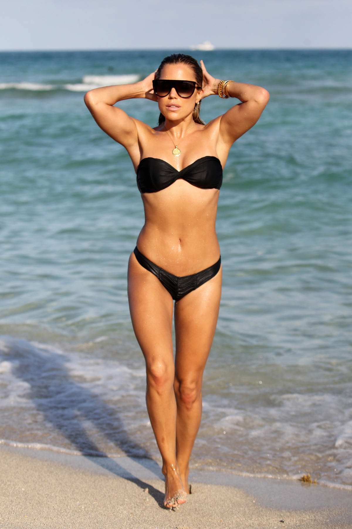 Sylvie Meis wears a black bikini while enjoying a beach day with fiance Niclas Castello in Miami, Florida