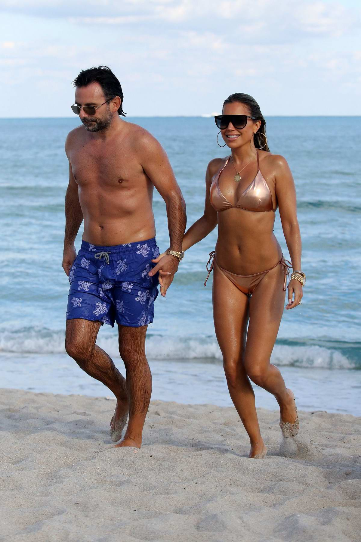 Sylvie Meis wears a metallic peach bikini while enjoying the beach with fiance Niclas Castello in Miami, Florida