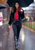 Victoria Justice rocks a black jacket paired with matching jeans and boots as she braves the rain in Midtown, New York City