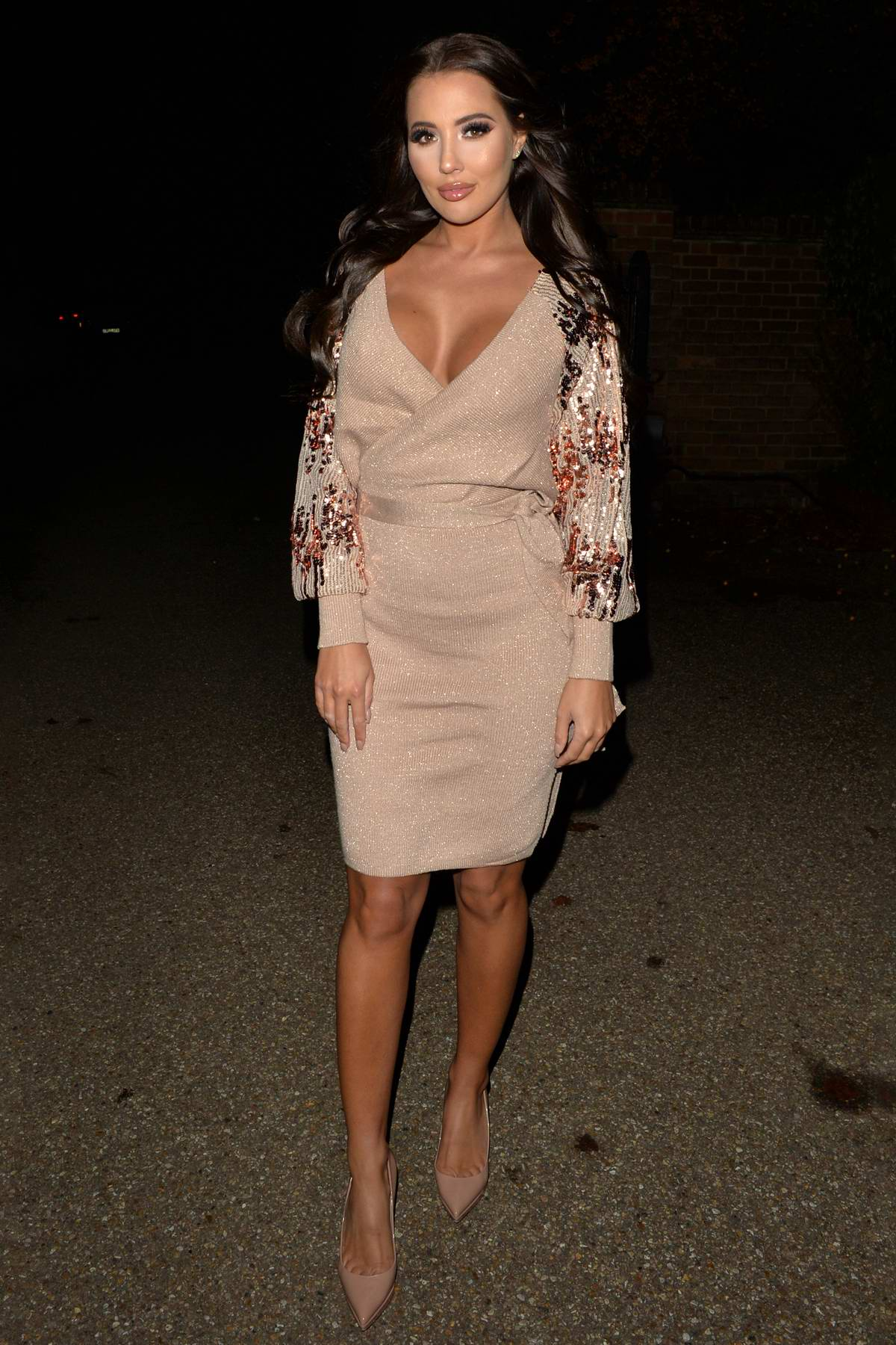 Yazmin Oukhellou seen wearing a beige dress during a night out at Alec's restaurant in Brentwood, Essex, UK