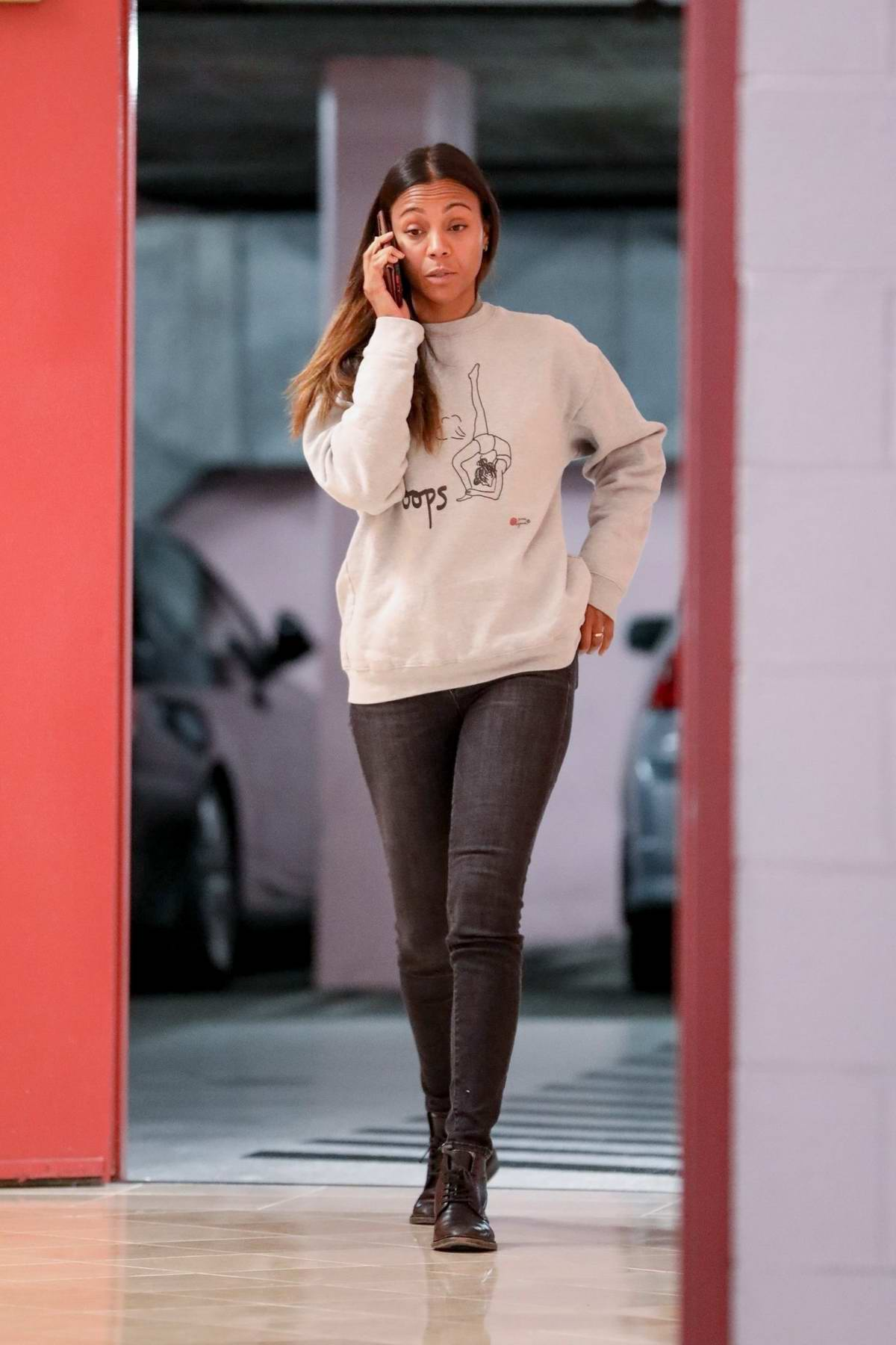 Zoe Saldana seen chatting on her phone as she arrives at a medical building in Beverly Hills, California
