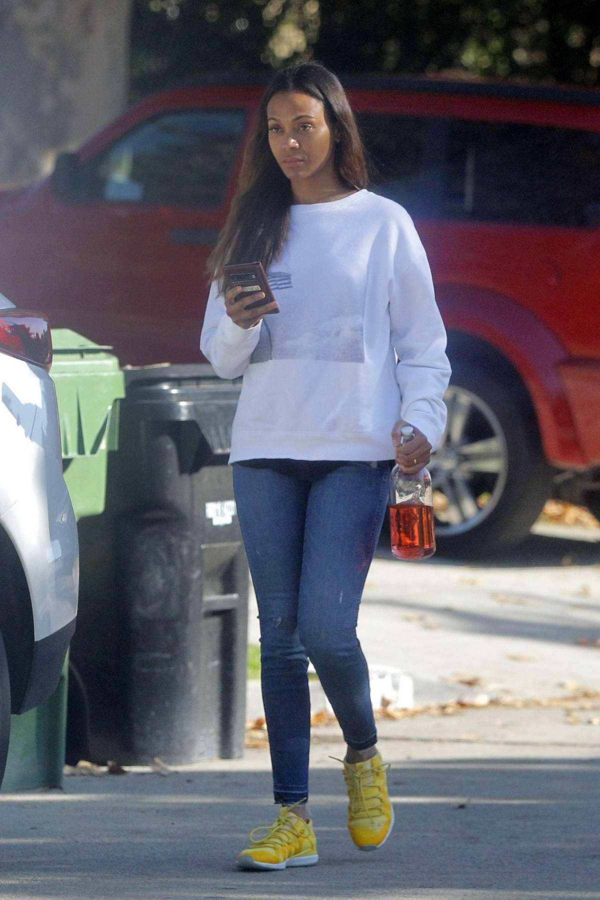 Zoe Saldana steps out makeup free as she runs a few errands in Beverly Hills, California