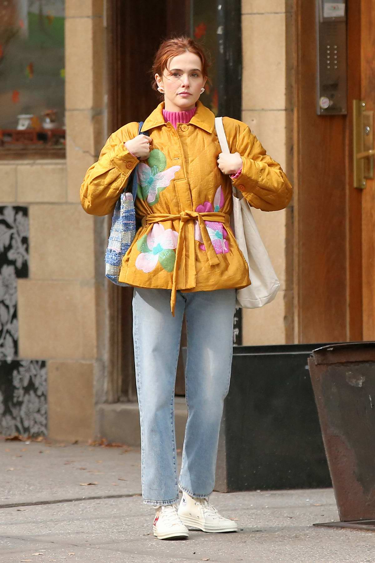 Zoey Deutch looks pretty in a yellow jacket as she leaves a coffee shop in New York City
