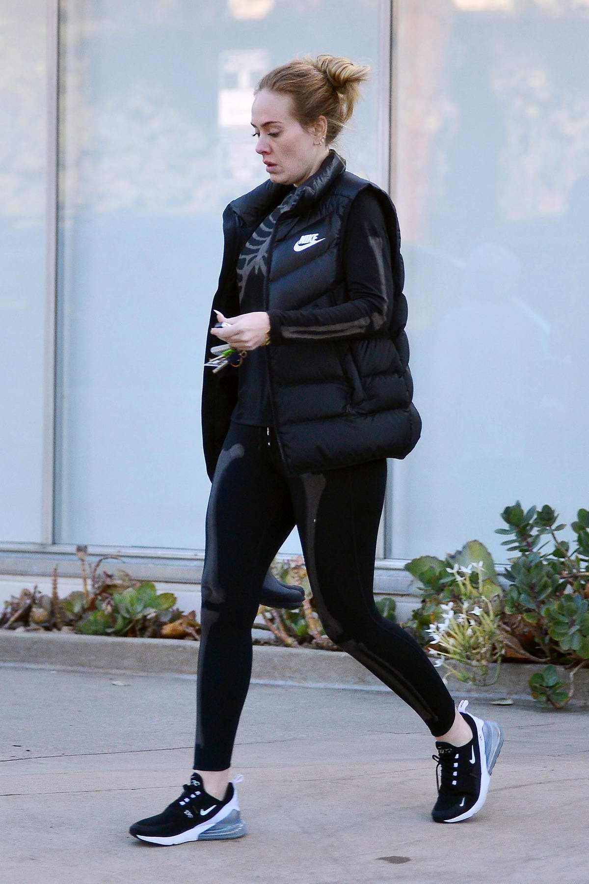 Adele seen wearing a puffy jacket and leggings as she leaves a library in Los Angeles