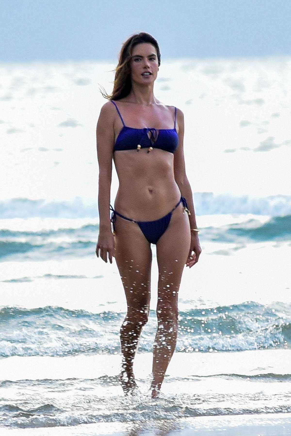 Alessandra Ambrosio looks amazing in a blue bikini during beach photoshoot for her new bikini collection in Florianopolis, Brazil