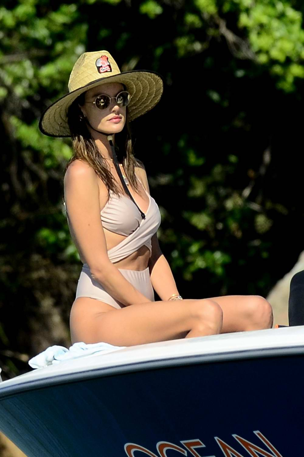 Alessandra Ambrosio sports a beige swimsuit as she enjoys another day on a boat with her family in Florianópolis, Brazil