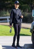 Alessandra Ambrosio sports a black sweatshirt and leggings while out for a hike with her dog in Pacific Palisades, California