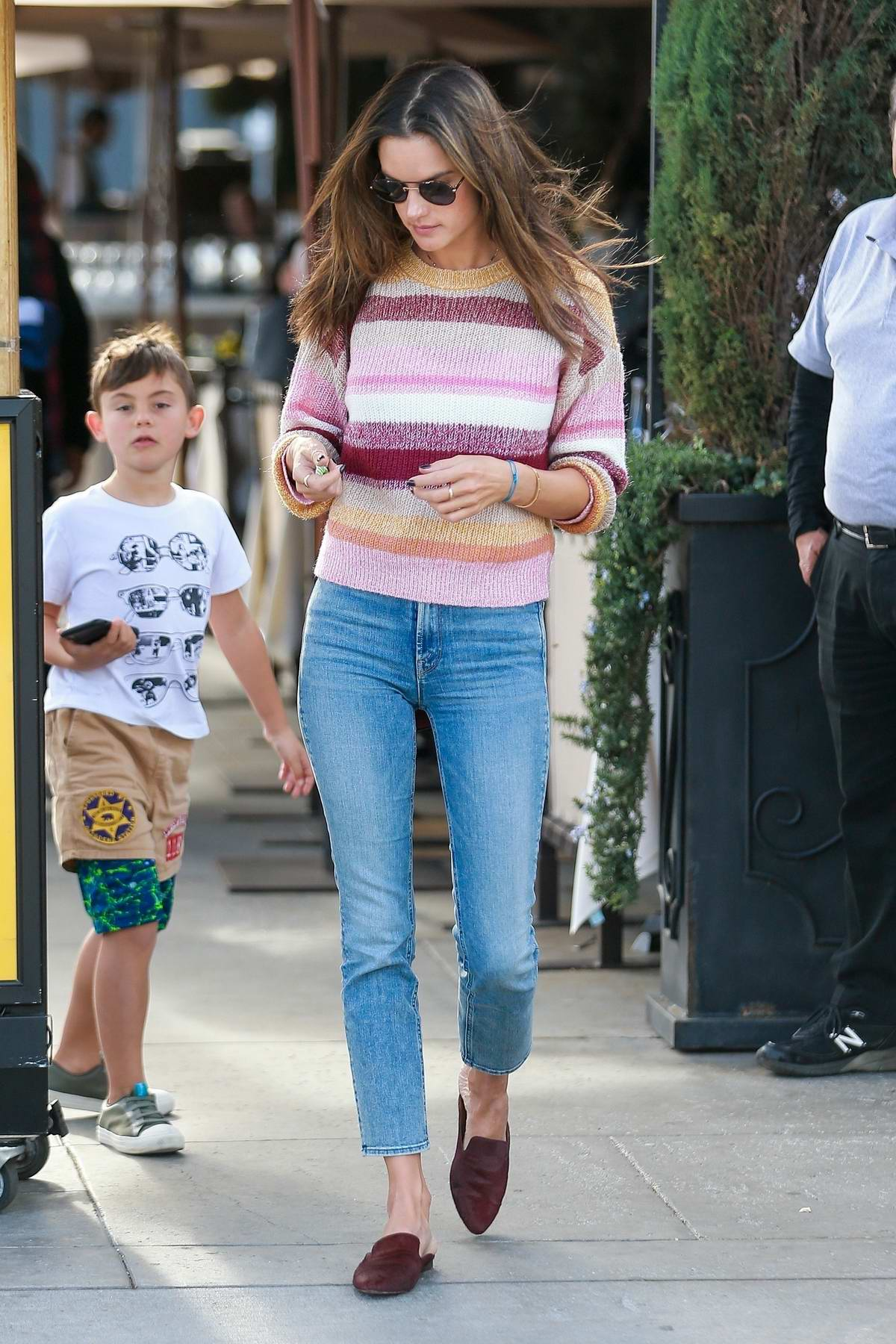 Alessandra Ambrosio waits for her ride after lunch with her parents at Il Pastaio in Beverly Hills, California