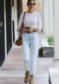 Alessandra Ambrosio wears a white top with high-waisted jeans while out running errands in Brentwood, California