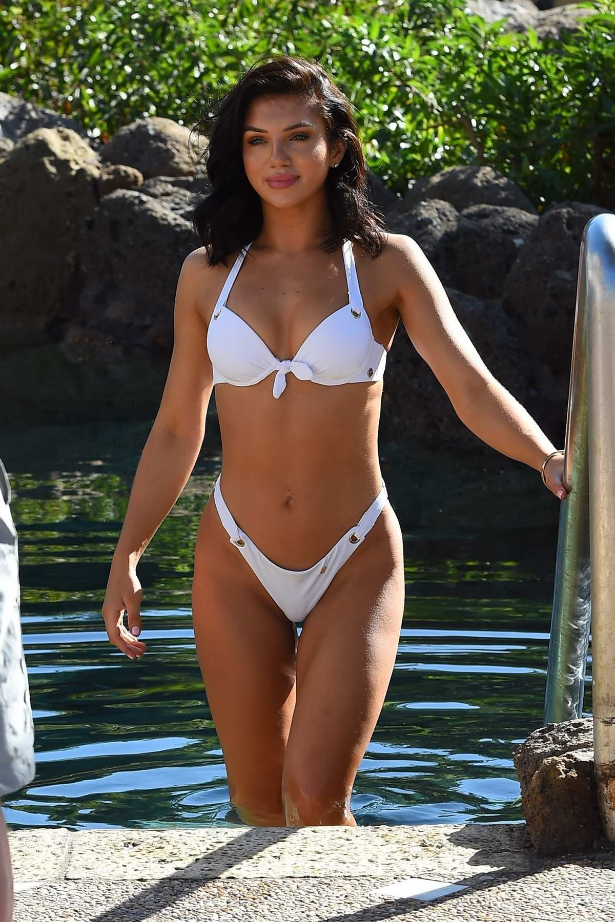 Alexandra Cane looks amazing in a white bikini while filming by the pool in Cuba