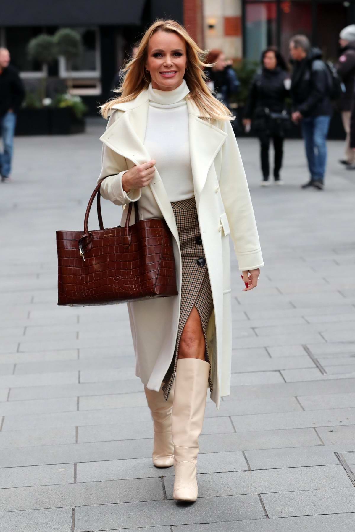 Amanda Holden looks stylish in gingham pattern skirt with a white top as she Leaving Heart Radio in London, UK