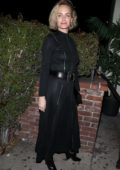 Amber Valletta heads for a New Year party at Delilah's in West Hollywood, California