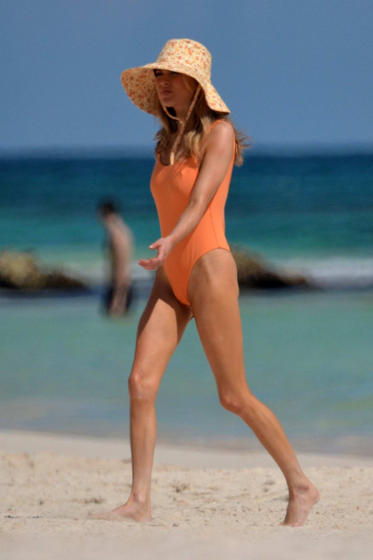 Anne Winters spotted in an orange swimsuit while enjoying some downtime with boyfriend Taylor Beau in Tulum, Mexico