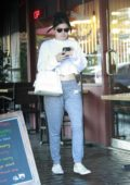 Ariel Winter keeps it casual in a crop top and Nike sweatpants while out on a coffee run in Los Angeles