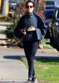 Ashley Tisdale keeps warm in a cozy sweatshirt and leggings while out in Los Angeles