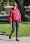 Ashley Tisdale sports a red hoodie and black leggings for a walk in Los Feliz, California