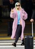Bebe Rexha looks comfy in a pink fur coat while sipping on a smoothie as she arrives at LAX in Los Angeles