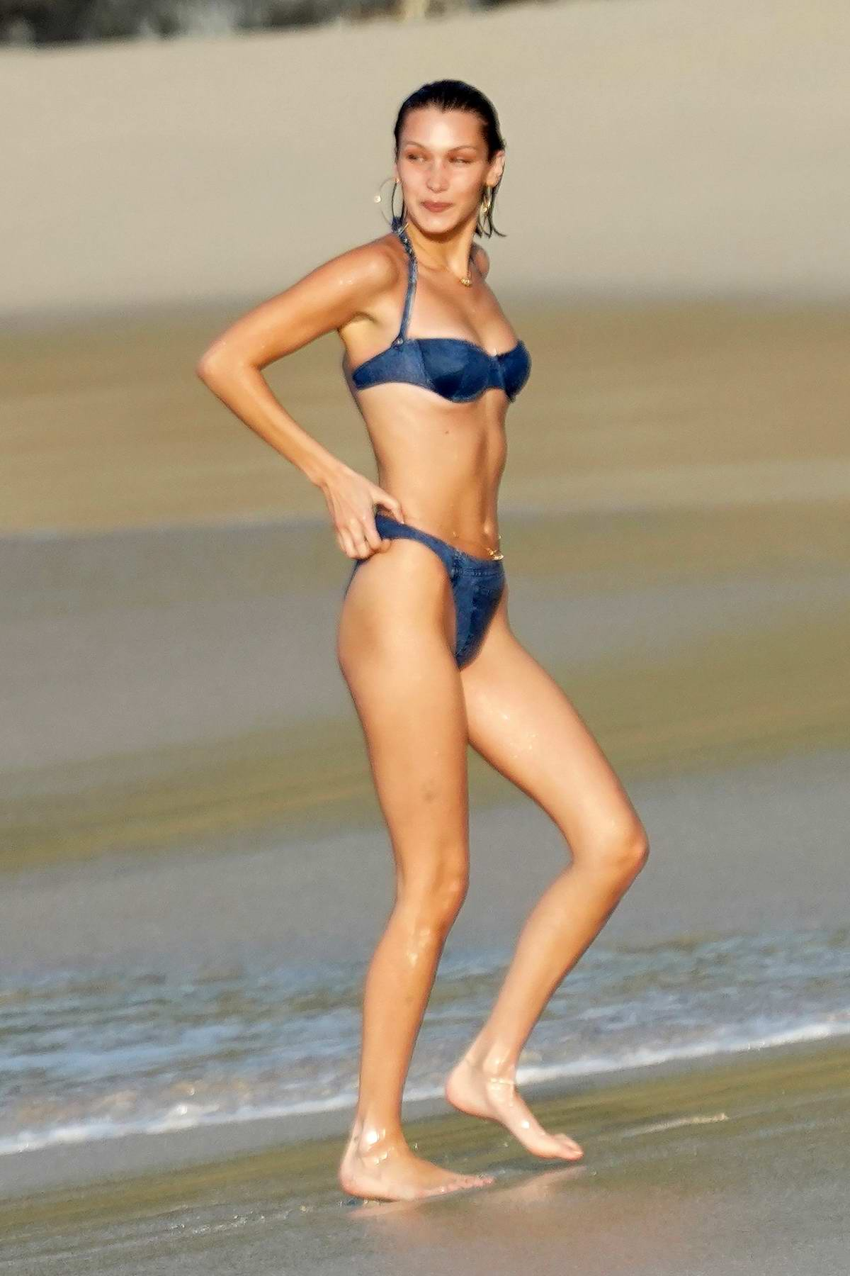 Bella Hadid hits the beach in a blue denim bikini as she wraps up the year in St Barts, France