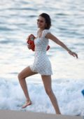 Bella Hadid looks pretty in a white dress as she strolls through the beach in St Barts, France