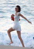 Bella Hadid looks pretty in a white dress as she strolls through the beach in St Barts, France
