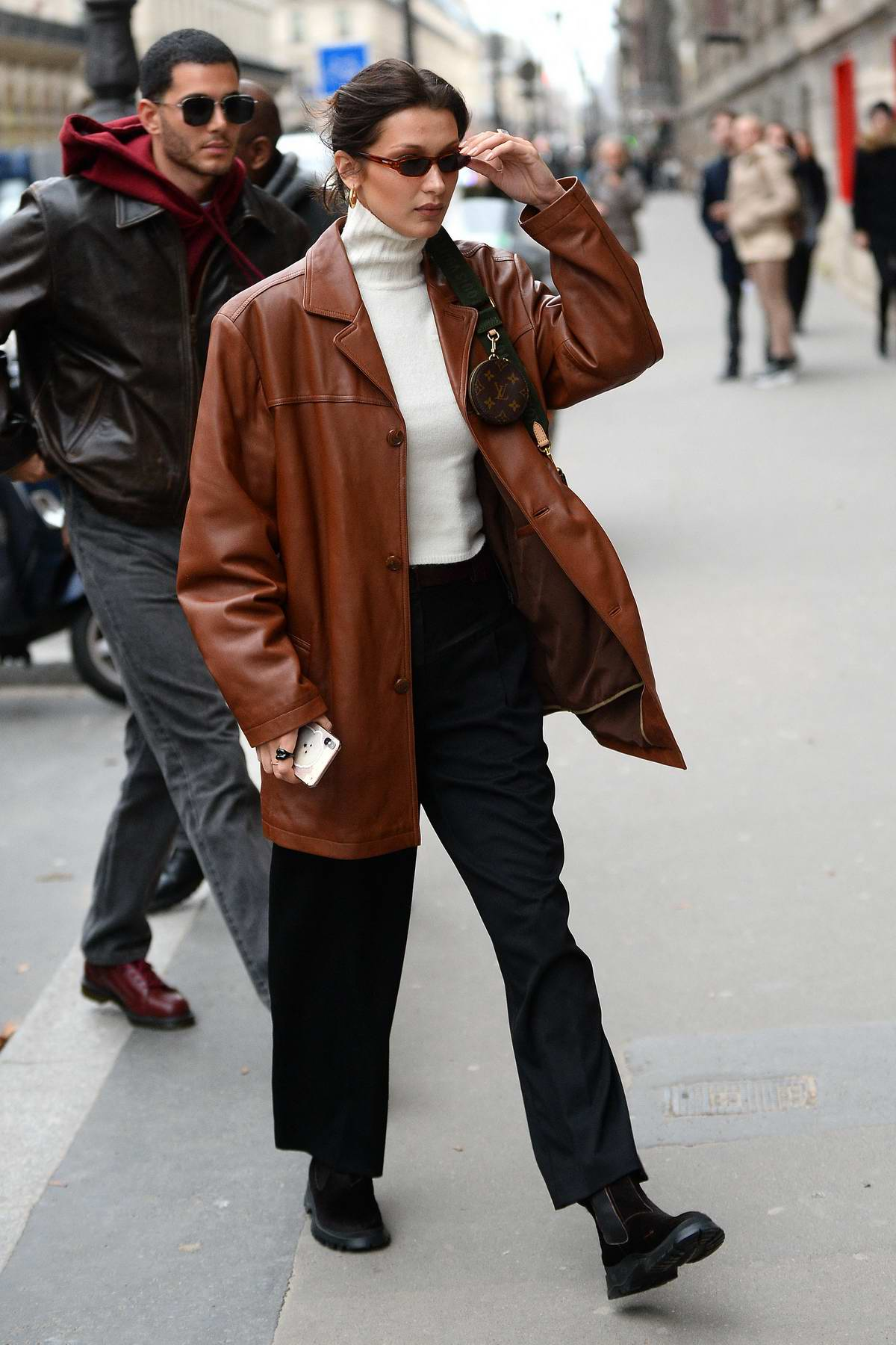 Bella Hadid looks stylish in a brown leather jacket as she heads to the Musee Des Arts in Paris, France