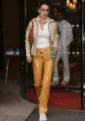 Bella Hadid looks super chic in yellow leather pants as she heads out with Fai Khadra in Paris, France