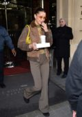 Bella Hadid seen holding her coffee as she leaves the Royal Monceau hotel in Paris, France
