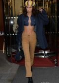 Bella Hadid shows off her toned midriff as she heads out of her hotel in Paris, France