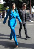 Bella Thorne seen wearing a blue suit as she arrives at the Women's March in Los Angeles