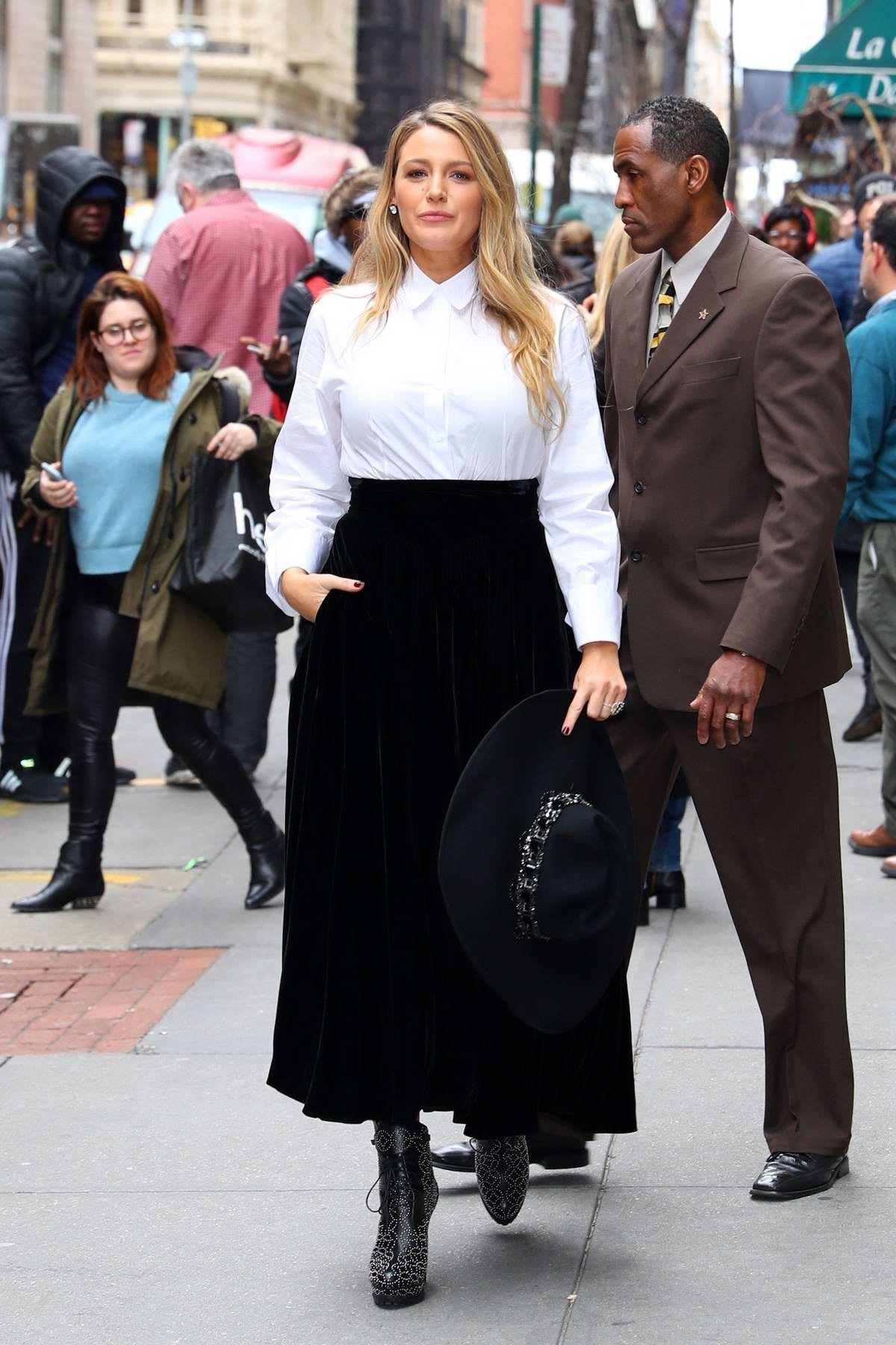 Blake Lively keeps it chic with a white shirt and black skirt as she leaves an office building in New York City