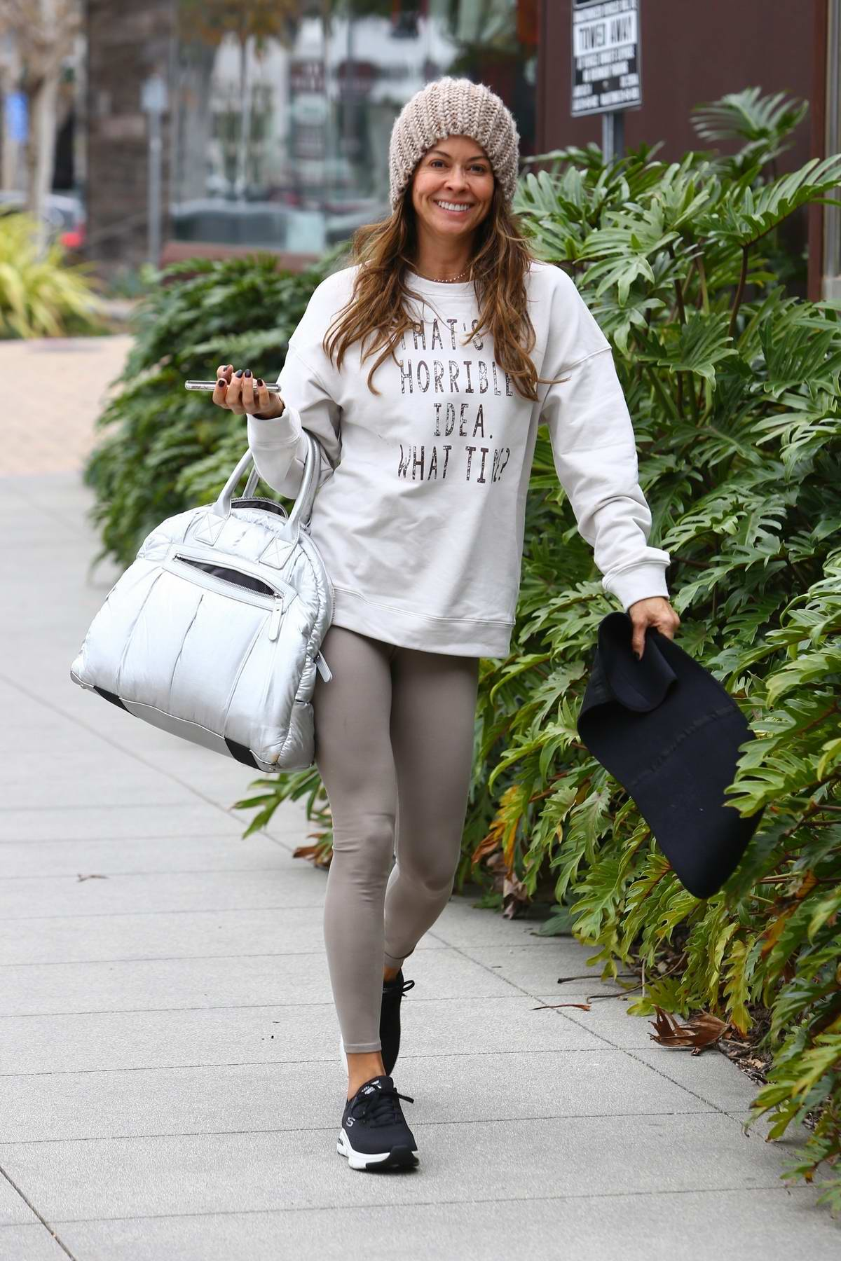 Brooke Burke is all smiles arriving for a Sunday morning workout in Malibu, California